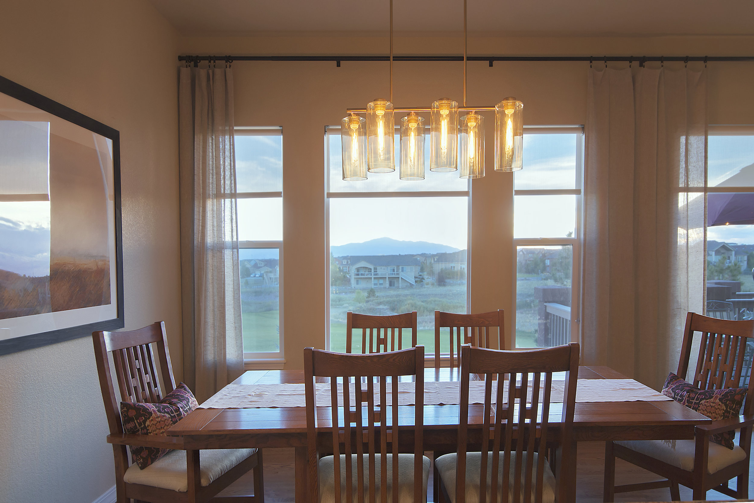 This stunning chandelier sets the stage for intimate dinners as this light and the pendant lights were placed on dimmer switches.  Check out that view!