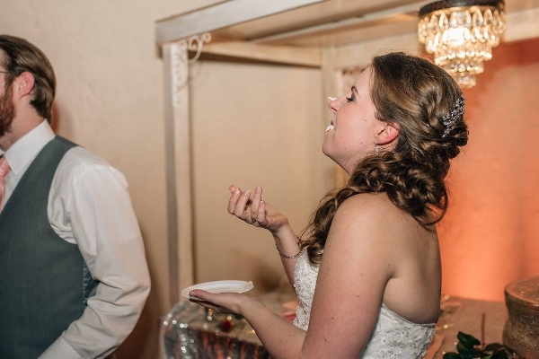 The hair and makeup survived the wedding, the reception, and the age-old cake tradition! Photo by  Rebecca Chesney Photography