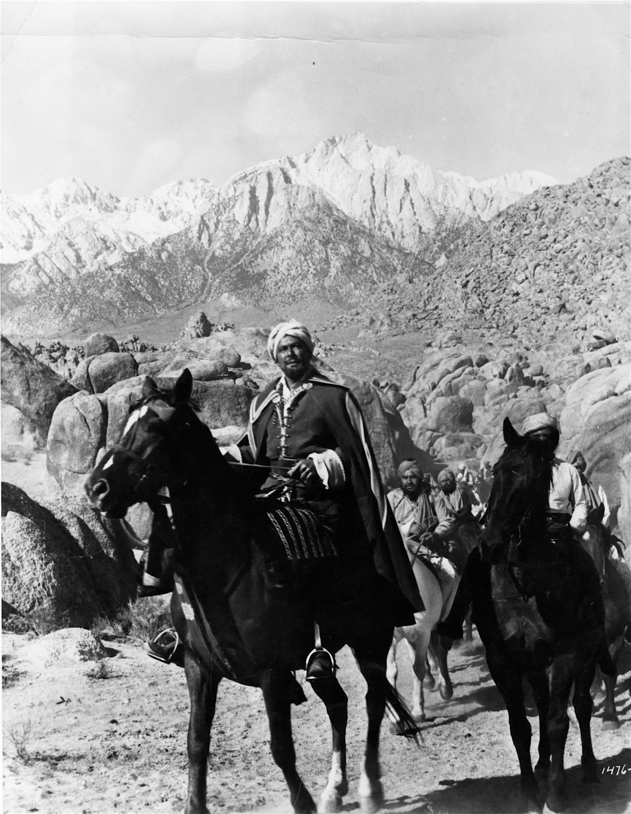 Errol Flynn rides through the Alabama Hills with Lone Pine Peak in the background.