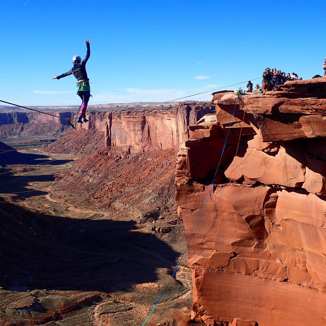 Liz Thomas highlines at the Fruit Bowl near Moab Utah during GGBY 2015