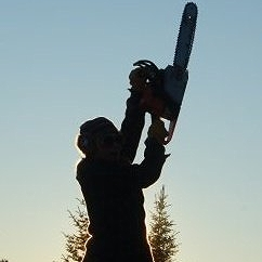 Libby Bushell silhouette with chainsaw