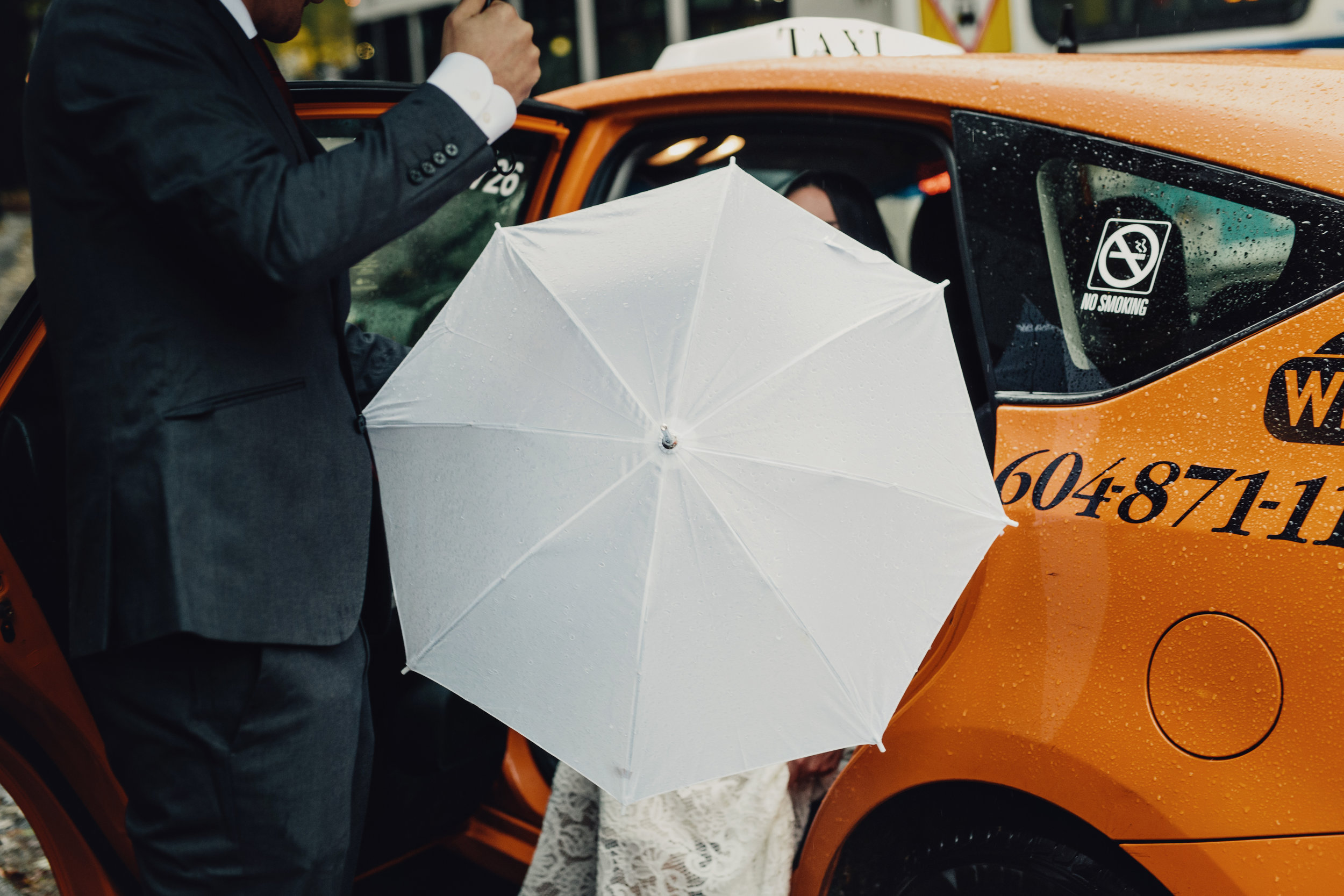 bride getting out of taxi in vancouver bc