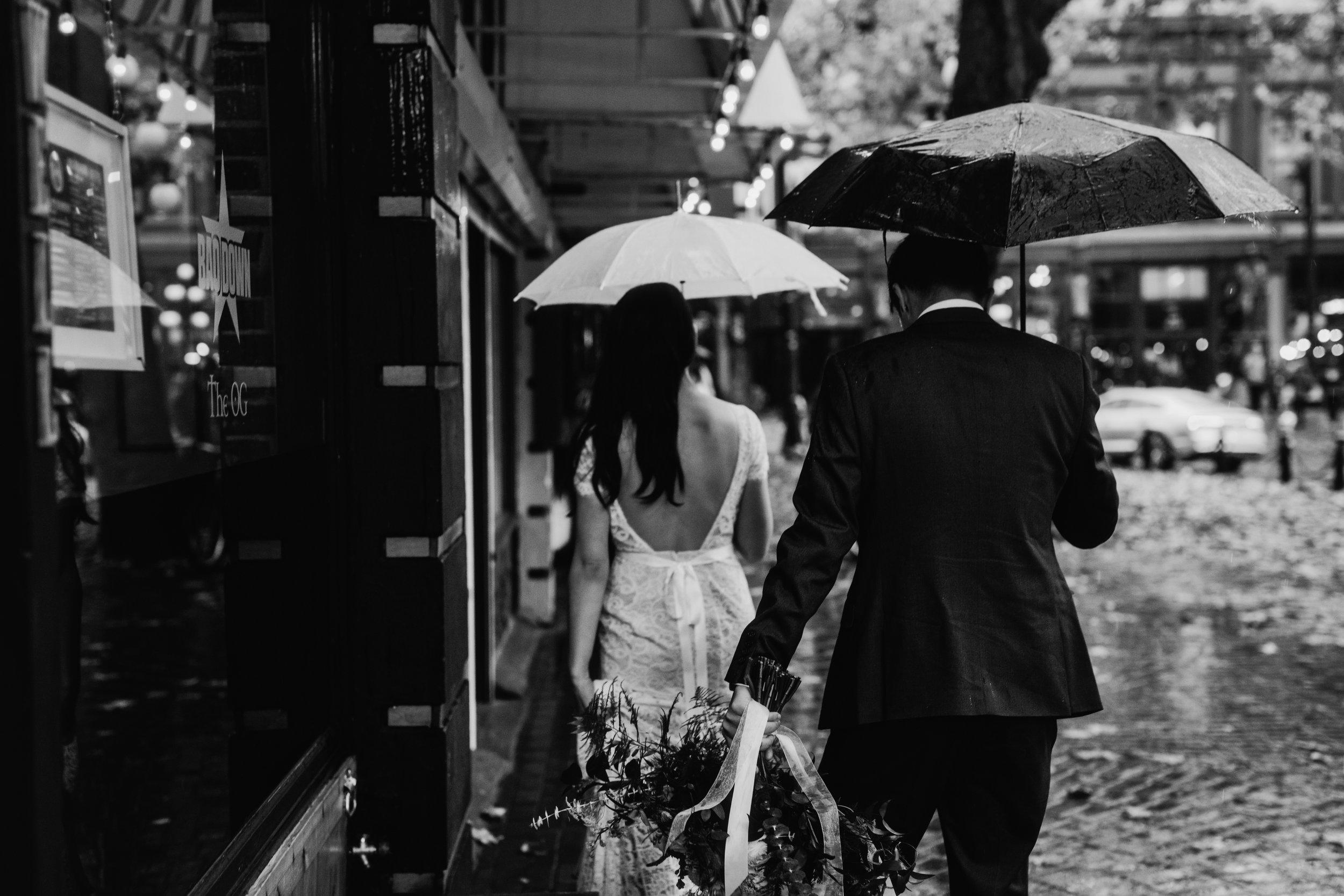 bride and groom walking in the rain in gastown vancouver