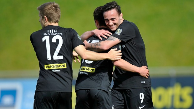 Team Wellington's Joel Stevens (centre) celebrates his goal with team-mates Tom Jackson (right) and Andy Bevin at Newtown Park on Sunday.