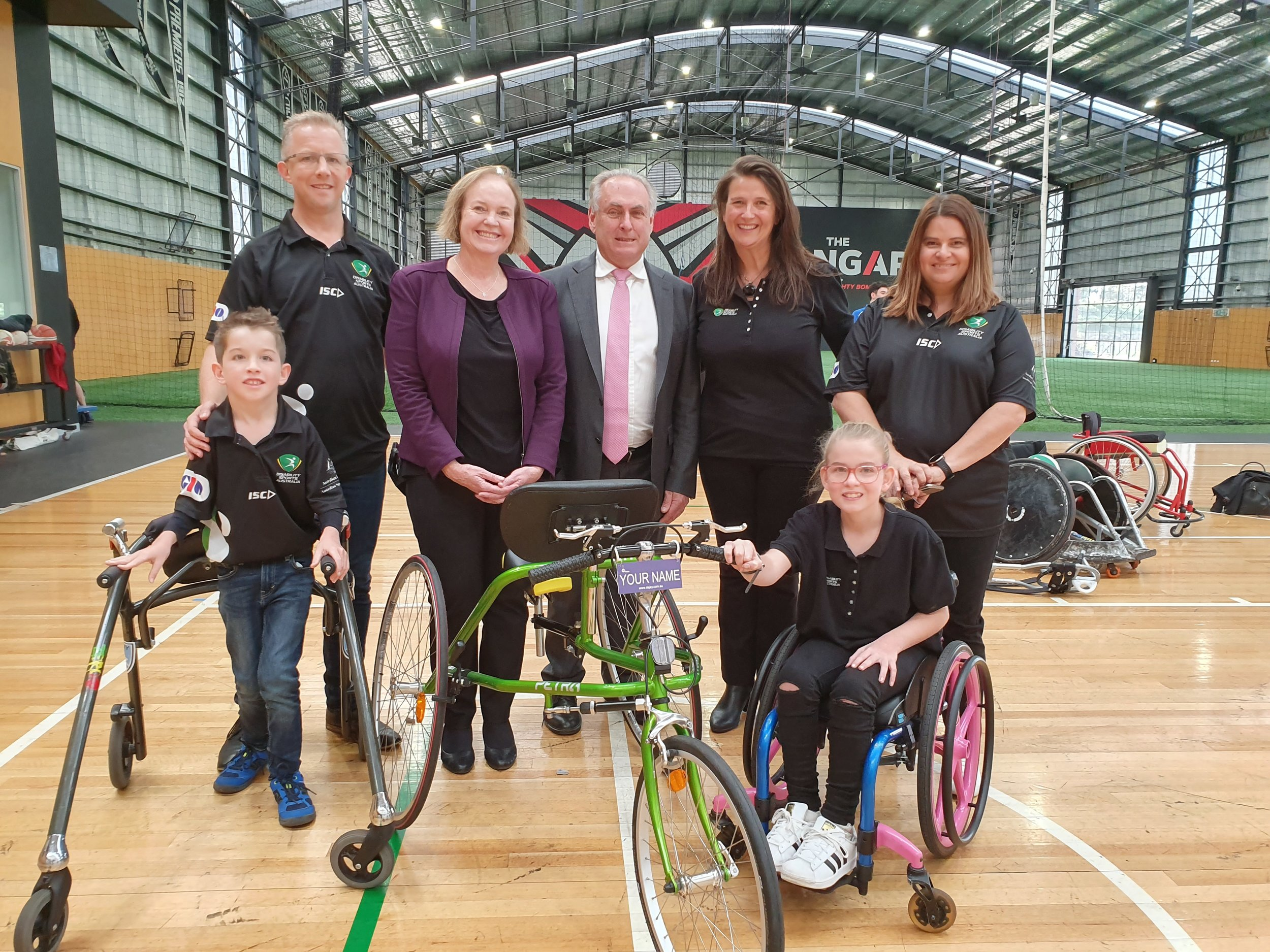 (L - R) Back Row: Mr Richard Keith (Acting Chair, RaceRunning Australia), Senator Carol Brown (Shadow Minister for Disability & Carers), Senator the Hon Don Farrell (Shadow Minister for Sport), Ms Jenni Cole (CEO, DIsability Sports Australia and Ms Jen Prior  Front Row: Mr Arran Keith (RaceRunning athlete) and Miss Emily Prior (Youth Ambassador, Disability Sports Australia)