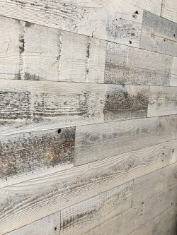 reclaimed wood wall installed in a new build to add character to builder grade finishes