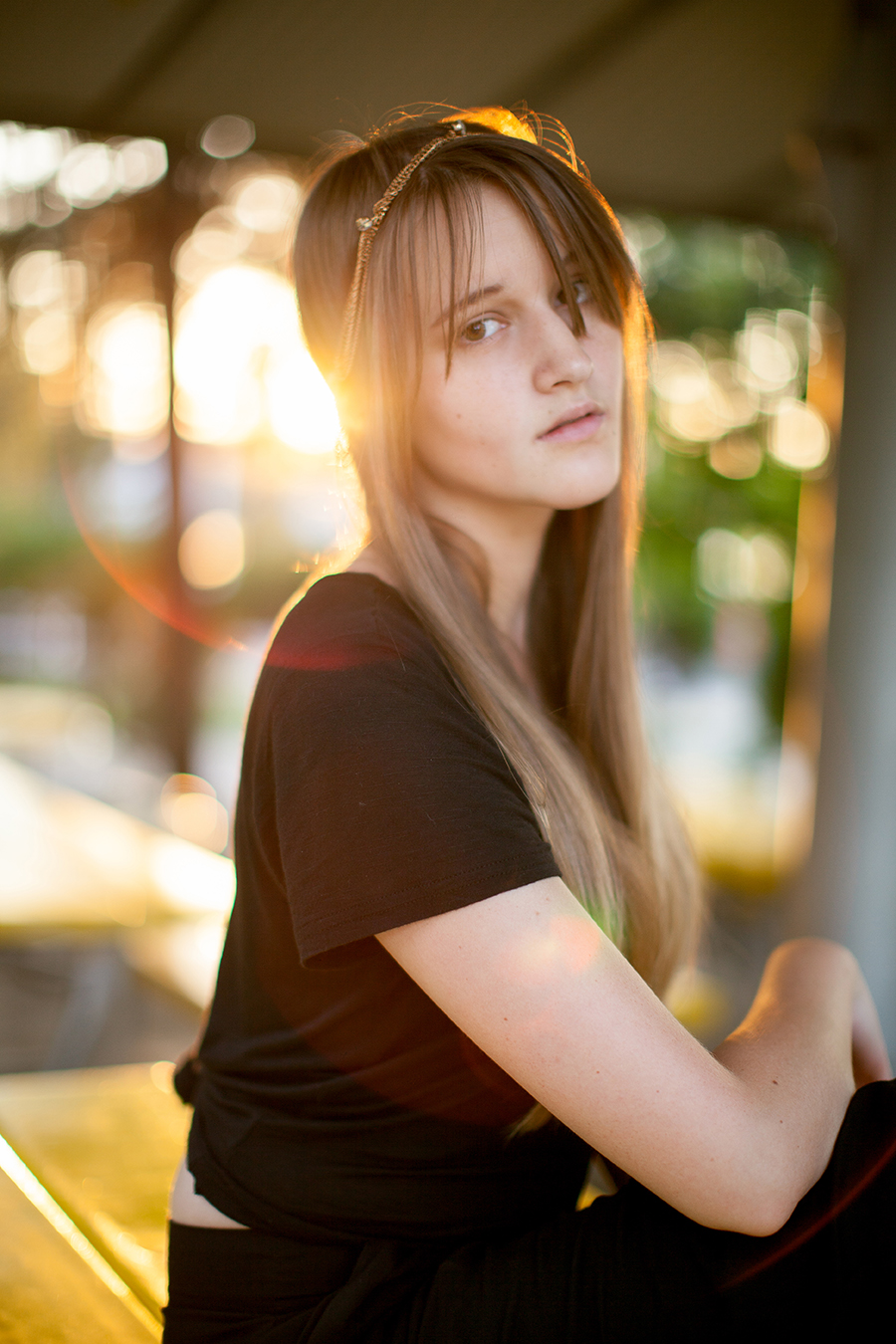 Super cool light and gorgeous model, but Annette is just sitting on a plastic picnic table in Denver.