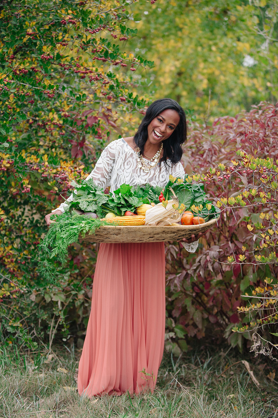 Another shoot I get asked about often.  This was just a few shrubs in the median of a parking lot on the industrial side of Longmont.  The vibrant colors of the foliage echoed the colors of the produce in her basket, and made her coral skirt stand out.  I'm standing on the curb.