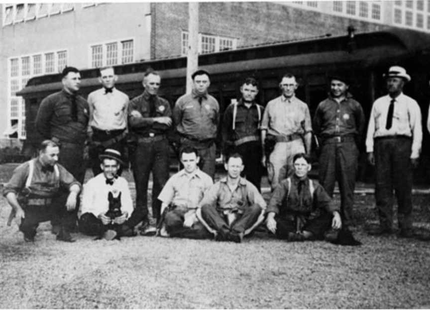 Railroad Police in 1920 at the Orient Railroad Yard in Wichita, Kansas. This yard was originally built by Kansas City, Mexico and the Orient Railroads. Seated to the far right is John Wesley Wolfe, John was born in 1879 in died in 1954 in Kansas.  Courtesy of Robert T. Wolfe grandson to John Wolfe.  *****************************************************************************************************************************************************************************************************