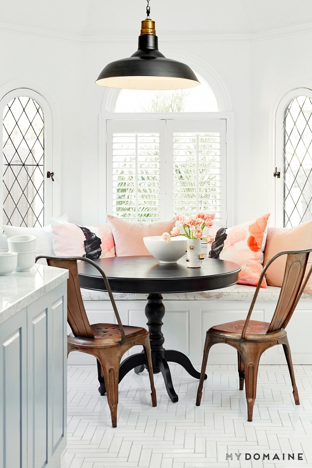 Rosa Frihet cushions by Shilo Engelbrecht on the bench seat of the bright Hollywood home of Nina Dobrev.  Interior by Consort Design.