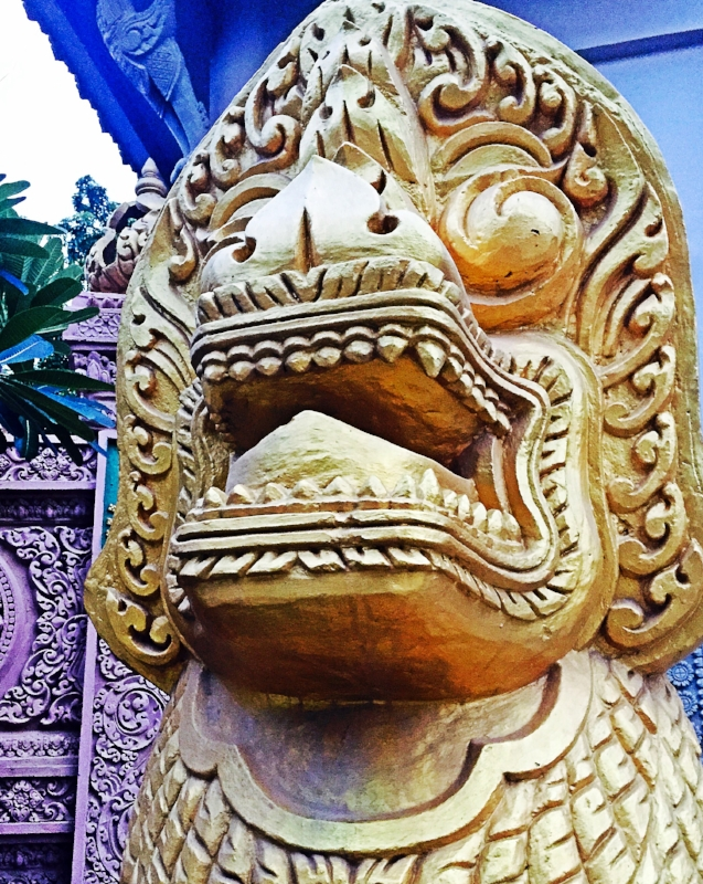 Standing guard outside a Wat