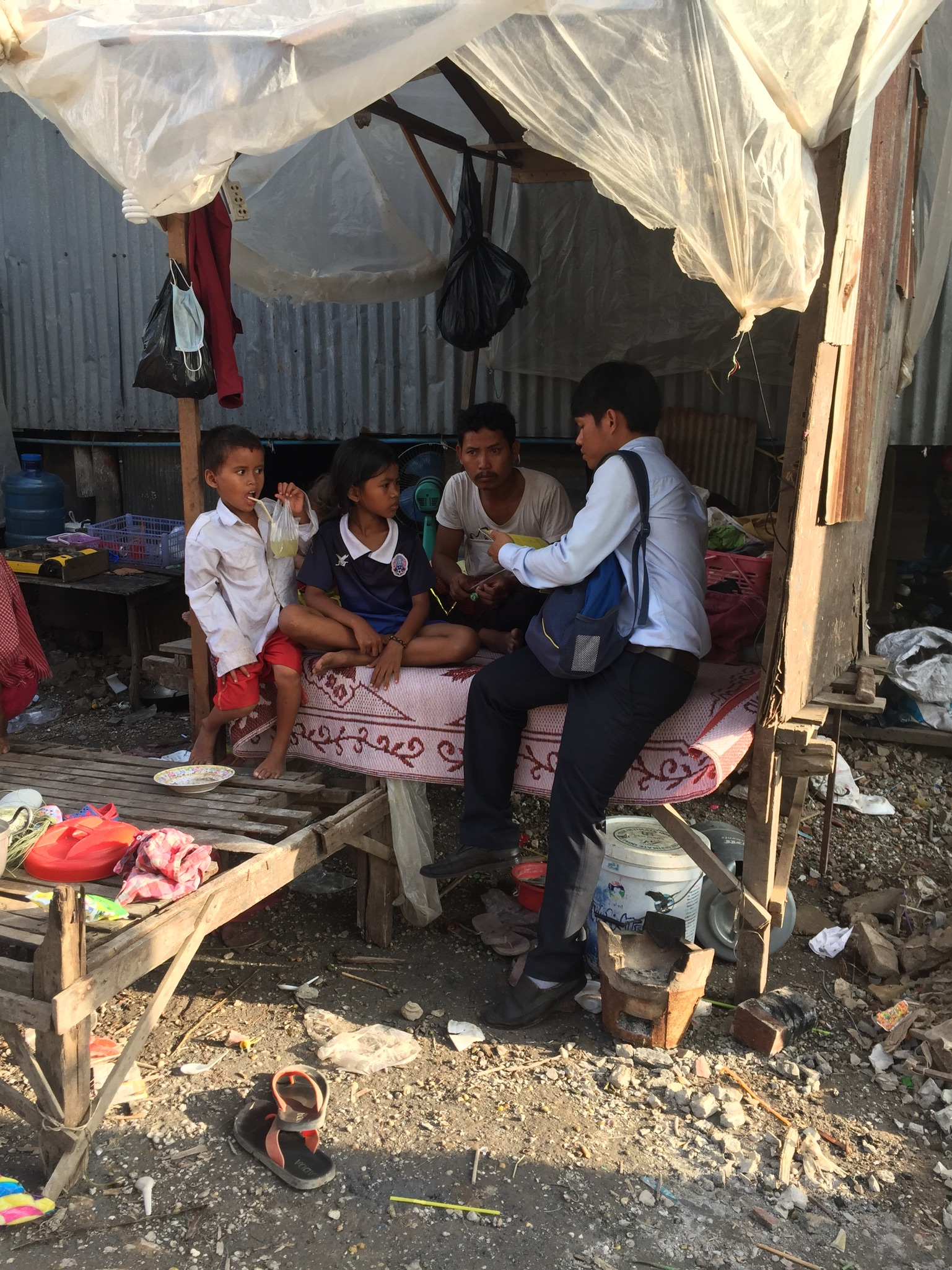 Poeurn meeting with one of the families, with five young kids, none were in school... and they had lost their mother