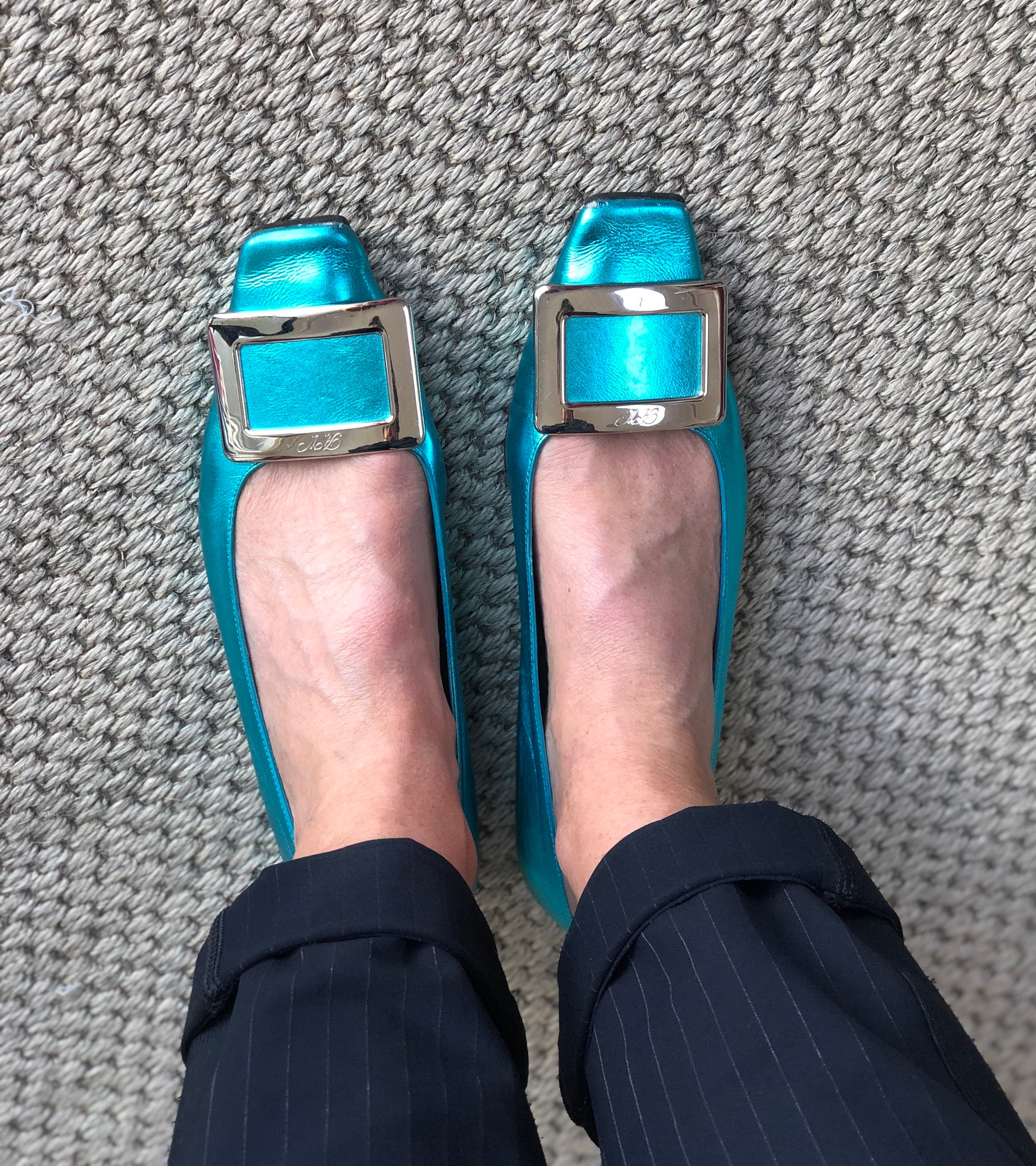 The most fantastic Roger Vivier pumps which compliment the cool tones of Manina's winter complexion.