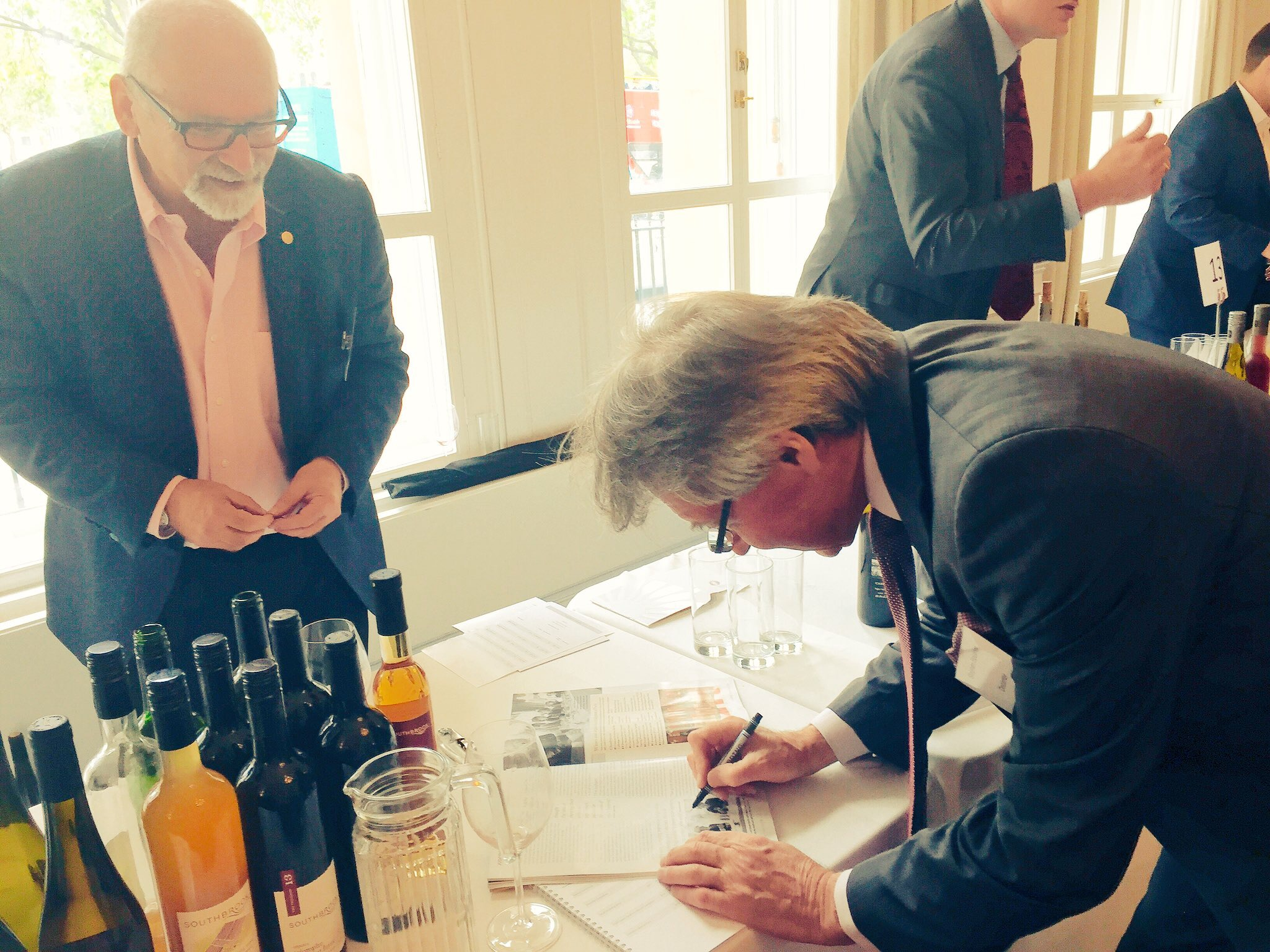 Stephen Spurrier signing an autograph for Bill Redelmeir, founder of Southbrook winery in Ontario, Canada
