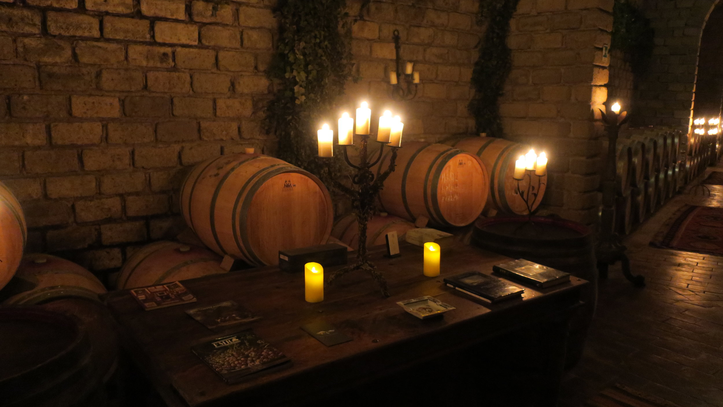 French Barrels resting in D'Amico Wine cellar that has been carved into Tufa rocks (Photo credit: Sumi_Sumilier)
