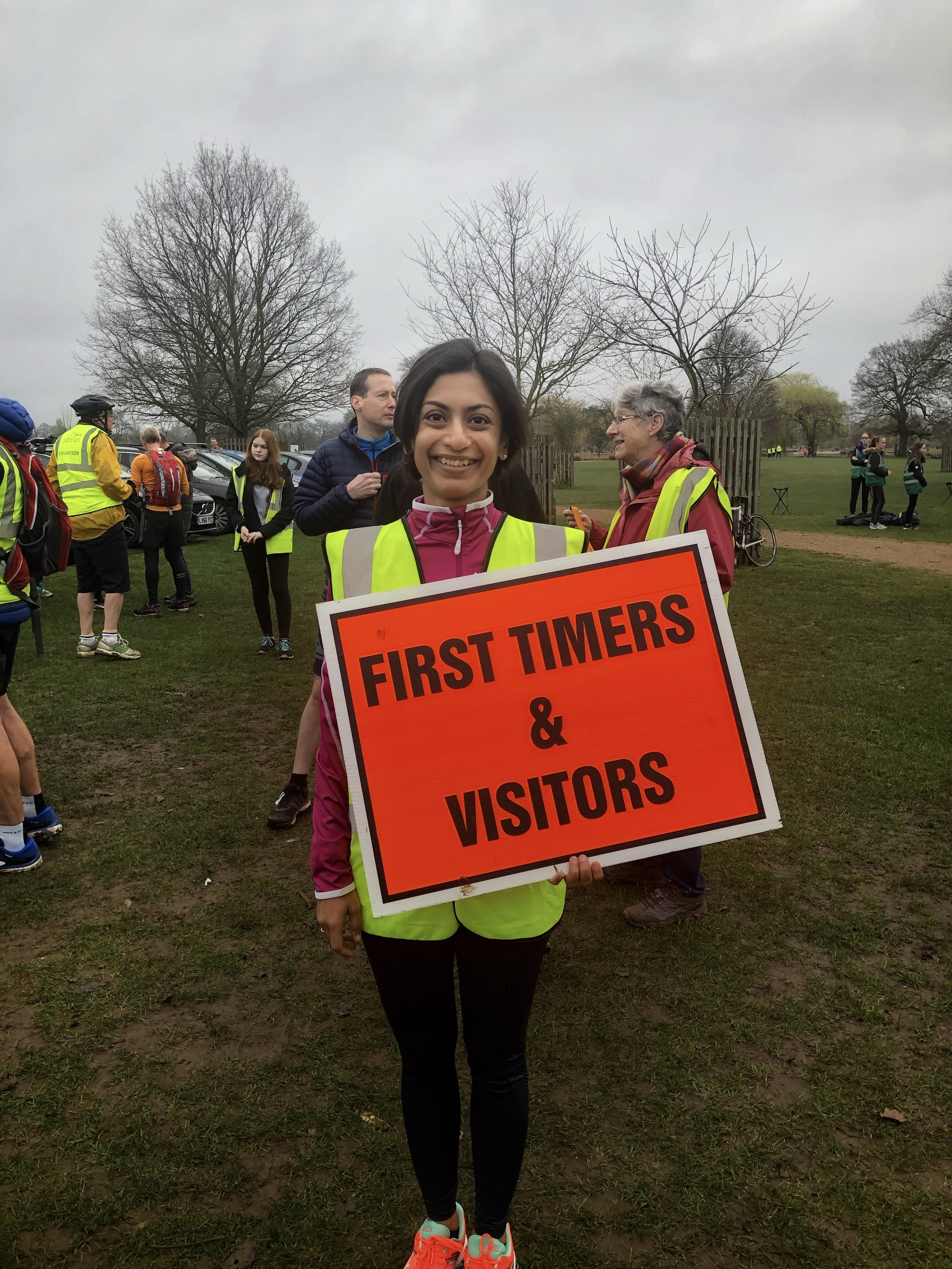 Holding the placard for briefing new runners and visitors. Communication breaks down barriers! (Image: Sumi Sarma)
