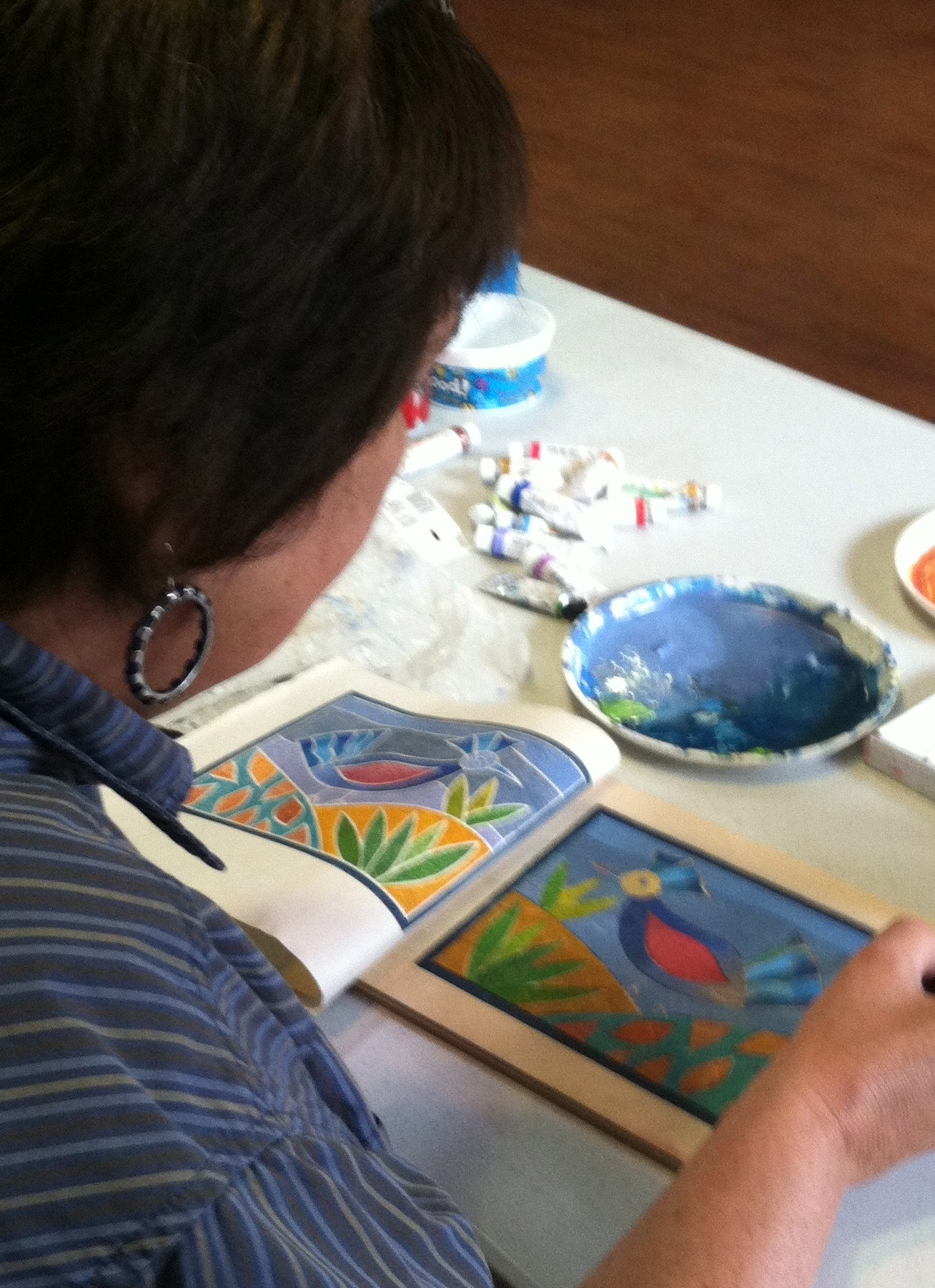 Painting the wood block with watercolor