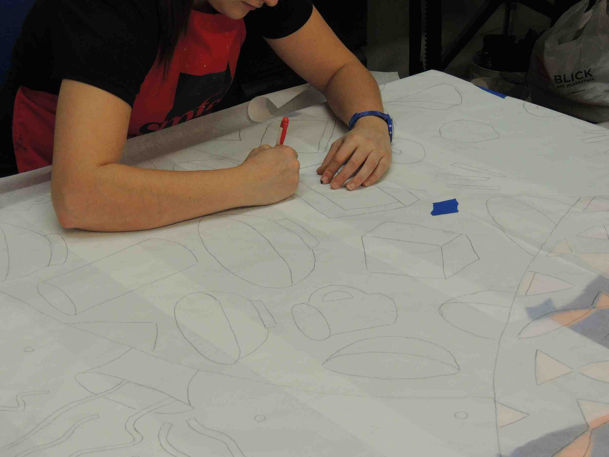 Rachel Newsam transfers the designs from the original mural onto the newly refreshed panels.