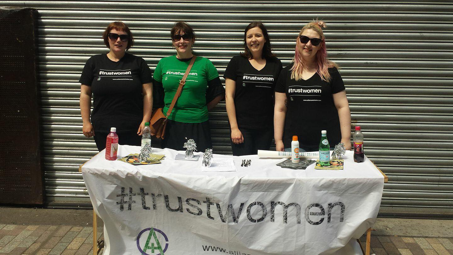 Image shows 4 volunteer activists at the Alliance for Choice Belfast Stall, City Centre