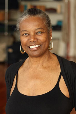 From Napa Valley, California, Jaki Nett has taught yoga since 1976 and Iyengar yoga since 1982. She holds an Intermediate Senior 1 Teaching Certificate, the highest certification of any African American woman in the United States. Jaki has studied under the tutelage of the world-renowned yoga master BKS Iyengar and Geeta Iyengar.