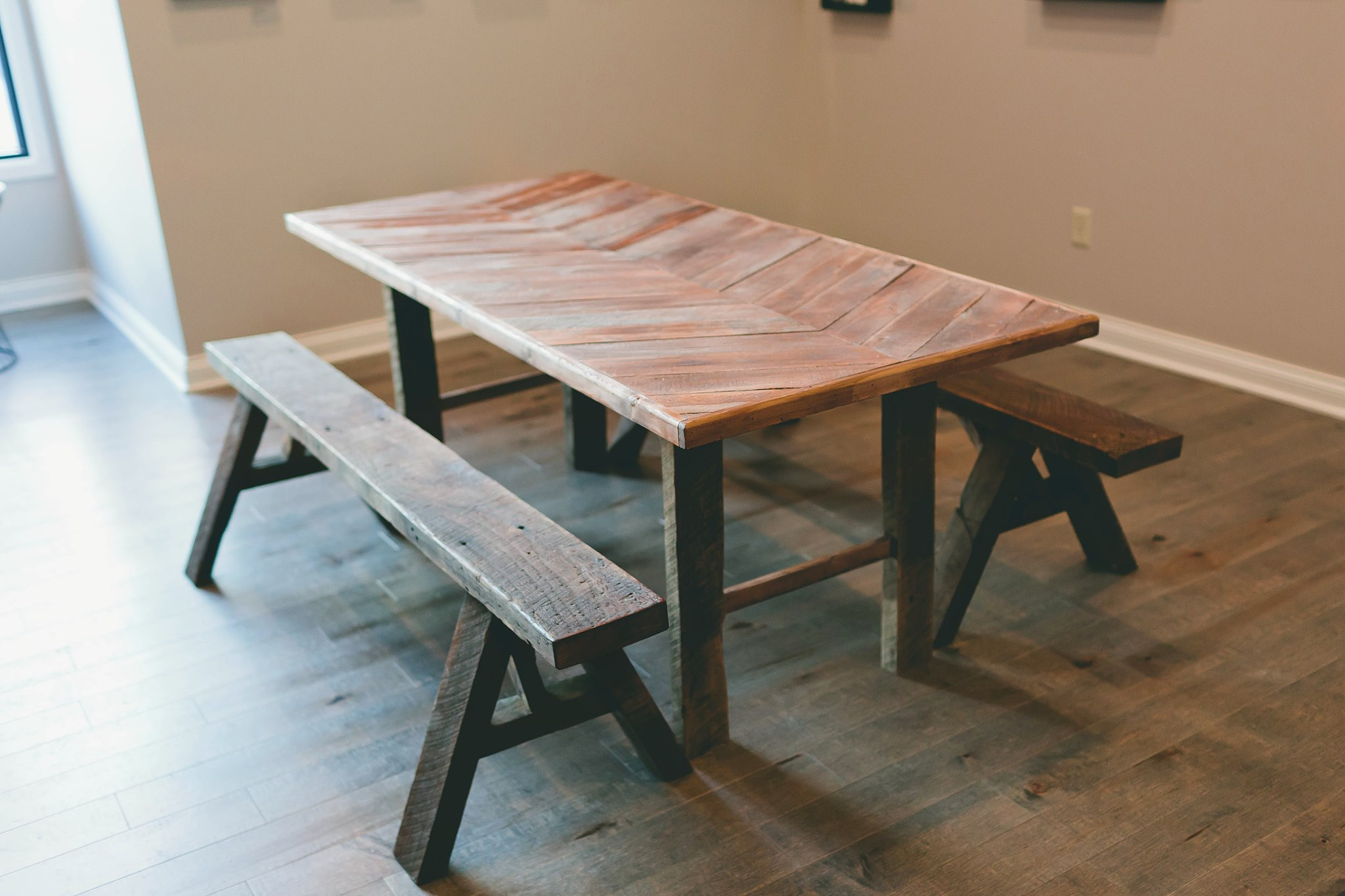 Reclaimed Dining Table $700  Available in chevron, herringbone and straight patterns.  Reclaimed A-frame bench $80 each