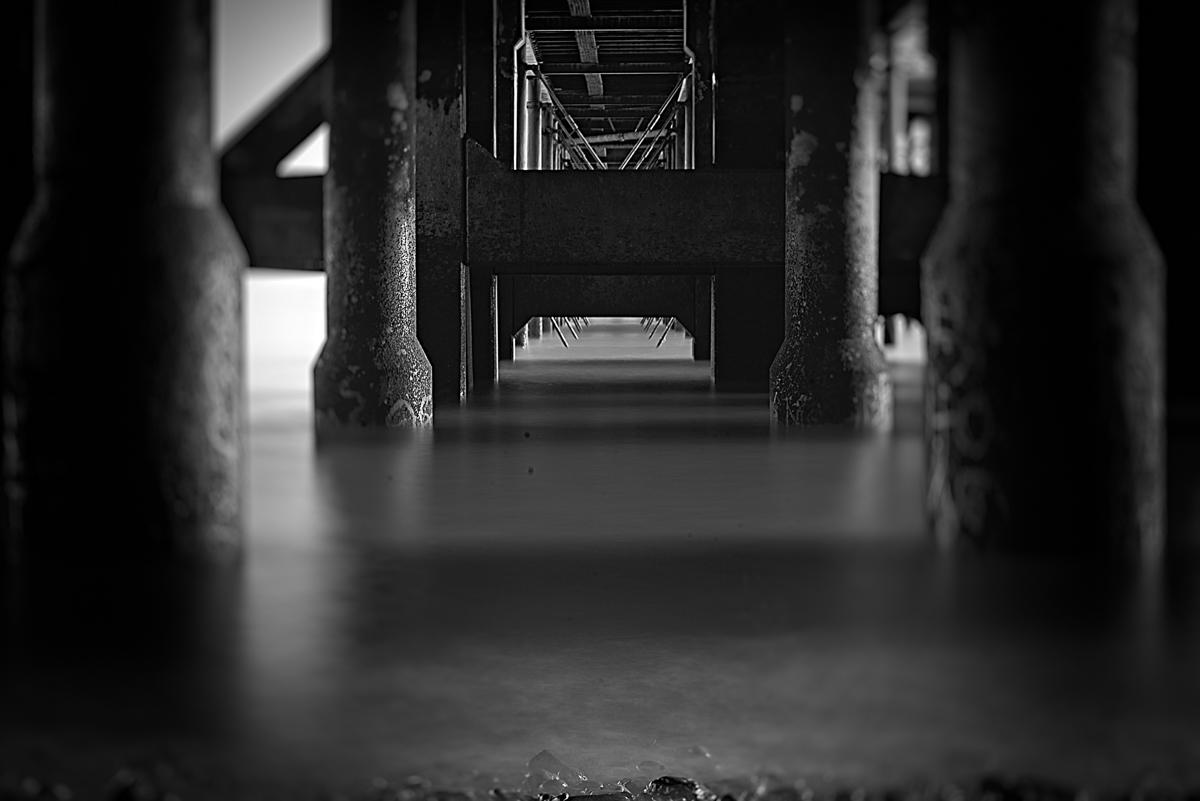 20 Second exposure under Penarth pier ... processed in Alien Skin Exposure 7 utllising the bokeh and focus sliders.