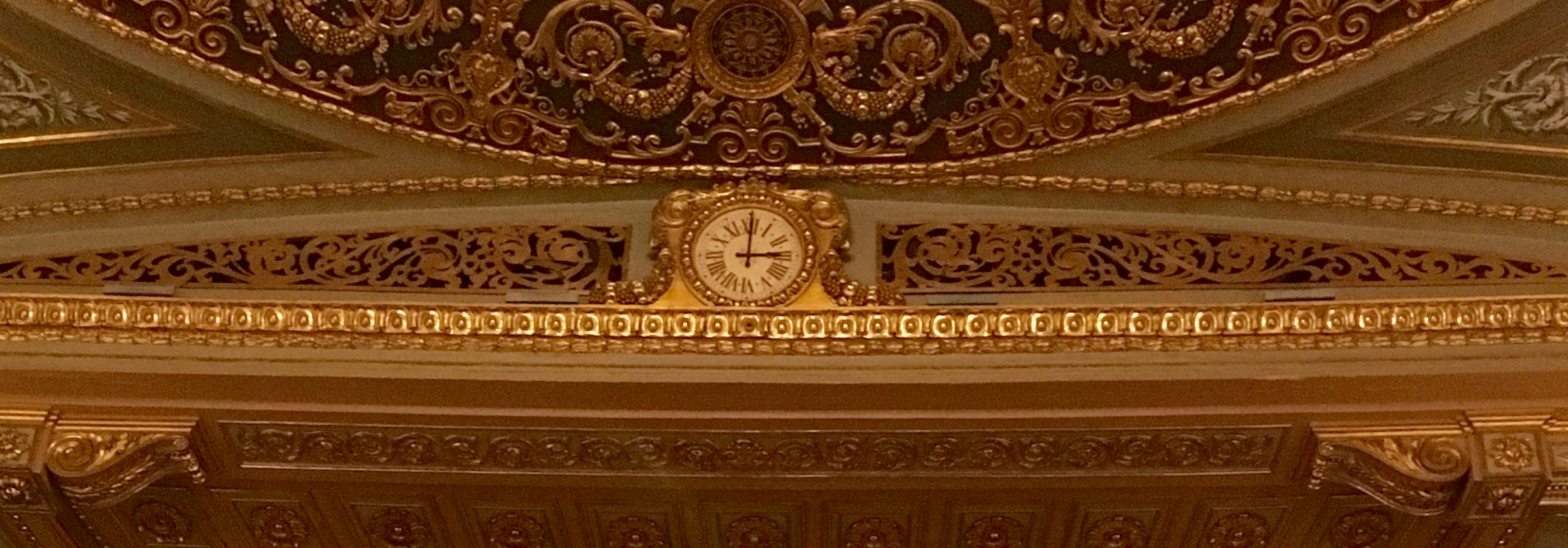 Detail of the clock above the stage at the Lisbon Opera House