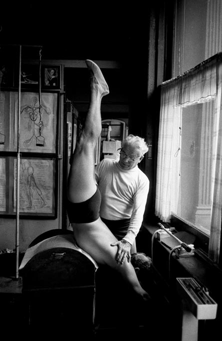 Joseph Pilates with a student on the Ladder Barrel