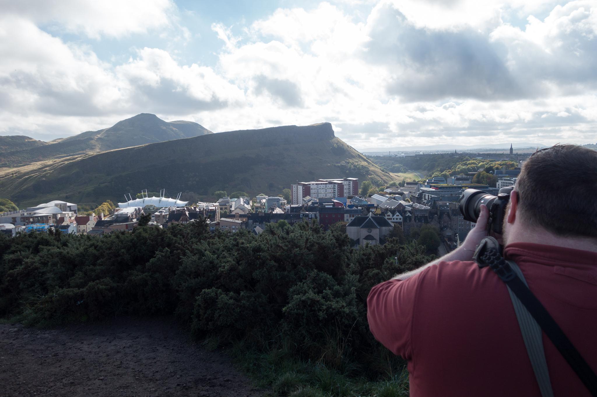 Brian taking a photo on Calton Hill in Edinburgh by Jess.
