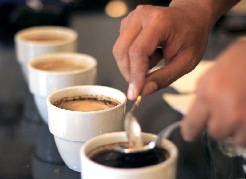 Mirza Luqman Effendy of Brewphobia in South Jakarta prepares coffee for a cupping session. -- Yosef Riadi for NPR