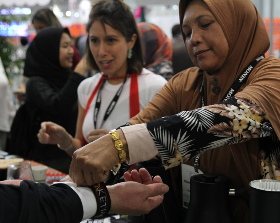KETIARA co-op's leader, Ramah, offered woven Ketiara wristbands to visitors. Photo: Sprudge