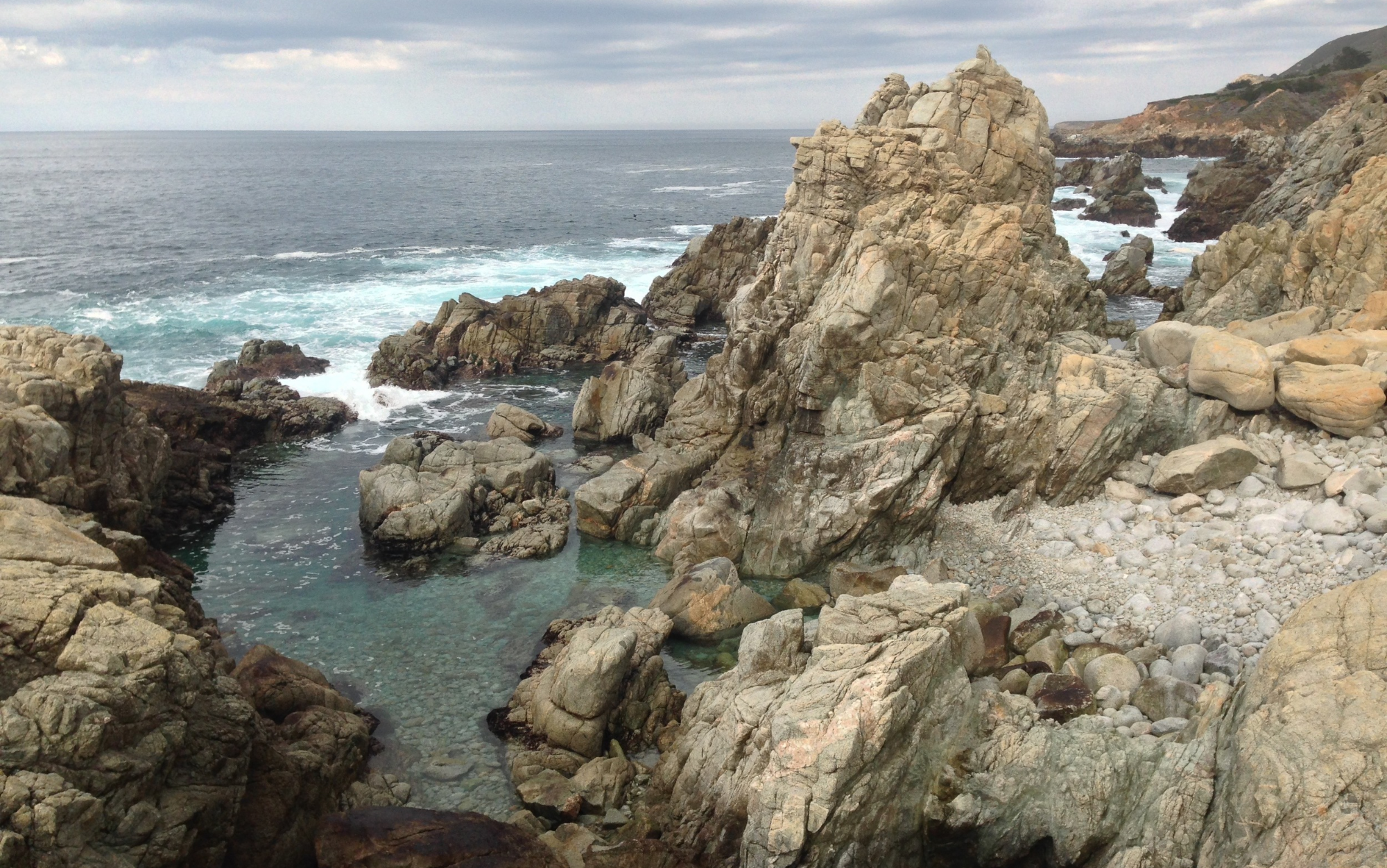 Marveling at the rugged beauty of the coastline, post-plunge. Big Sur, California. Photo credit: Chris Korbulic