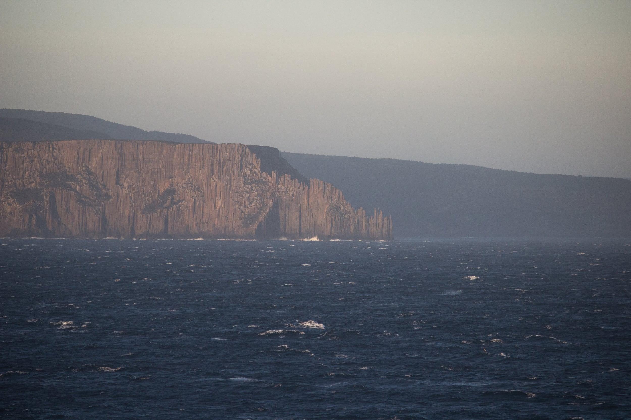 Wall to wall. Wave meets rock.Tasman Peninsula.