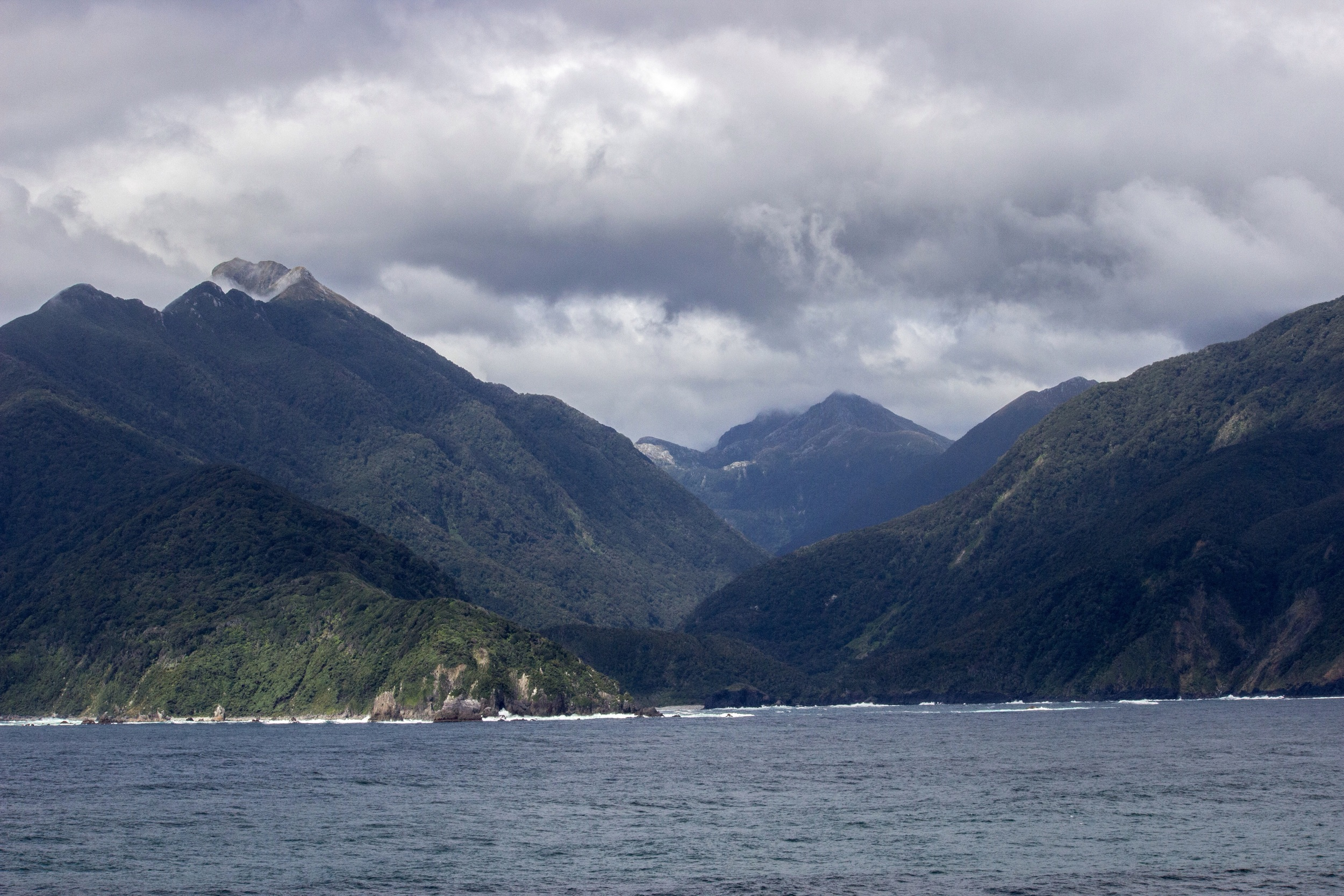 Moody mountains of the Fiordland coastline. South Island, New Zealand.
