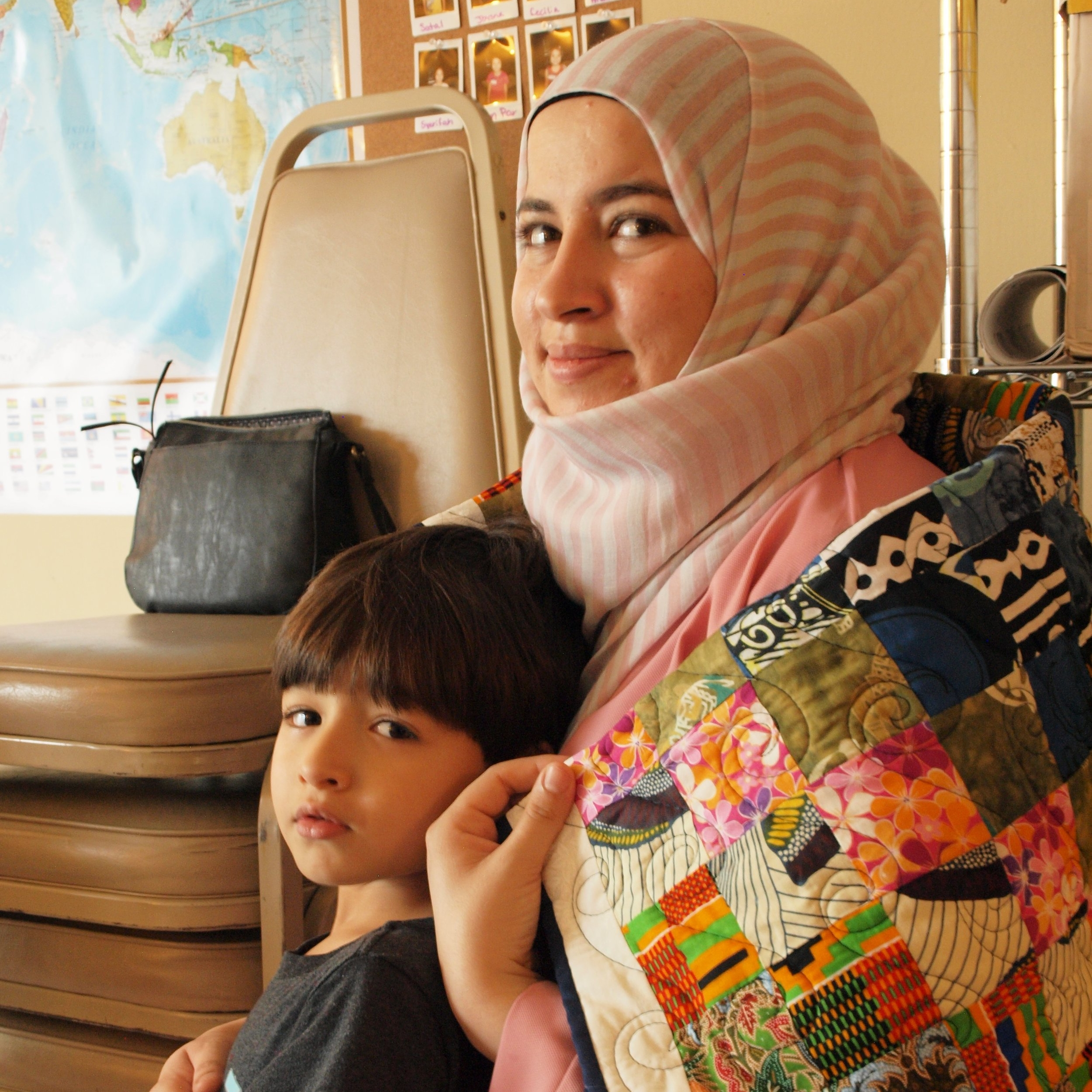 Muna and Her Son with the Quilt Made by Kay