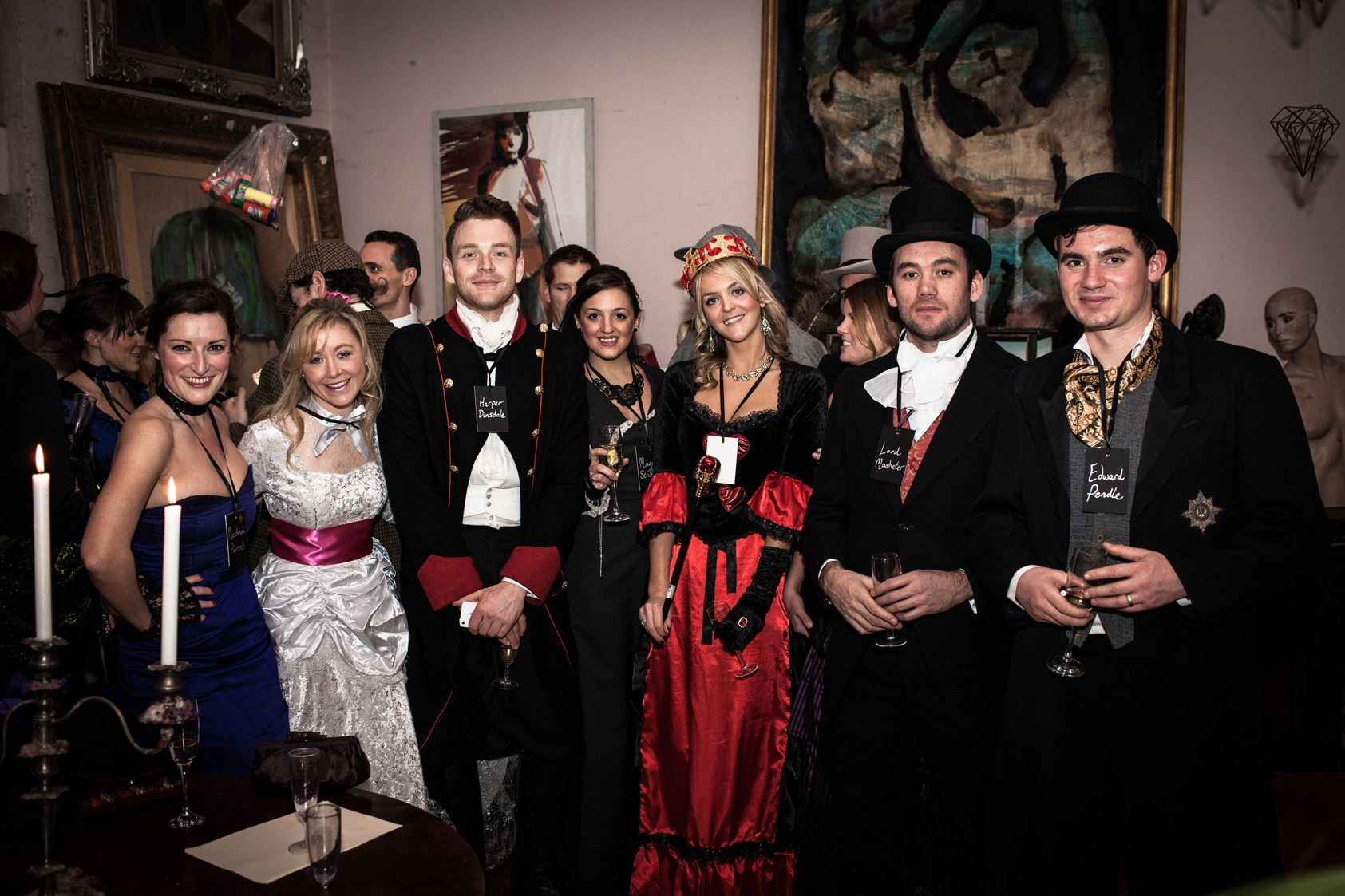 Characters assemble at a Victorian murder mystery dinner party