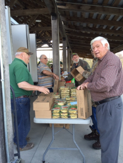 Bobby, Duane and Jimmy sorting and packing