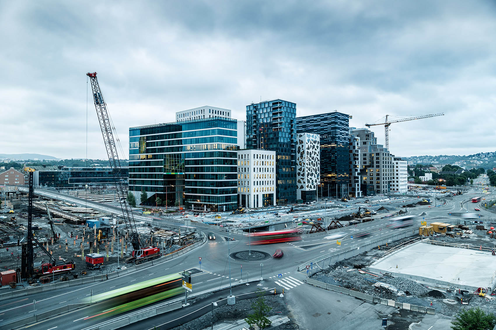 commercial industrial construction of modern cityscape with cranes and traffic in Oslo Norway