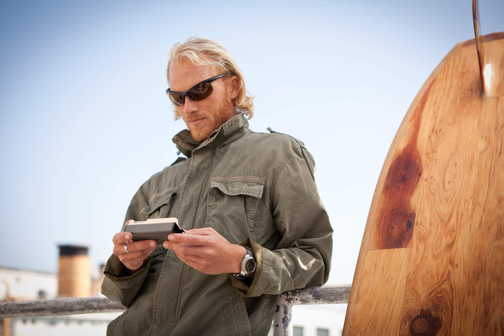 Surfer using a technology smartphone tablet outside