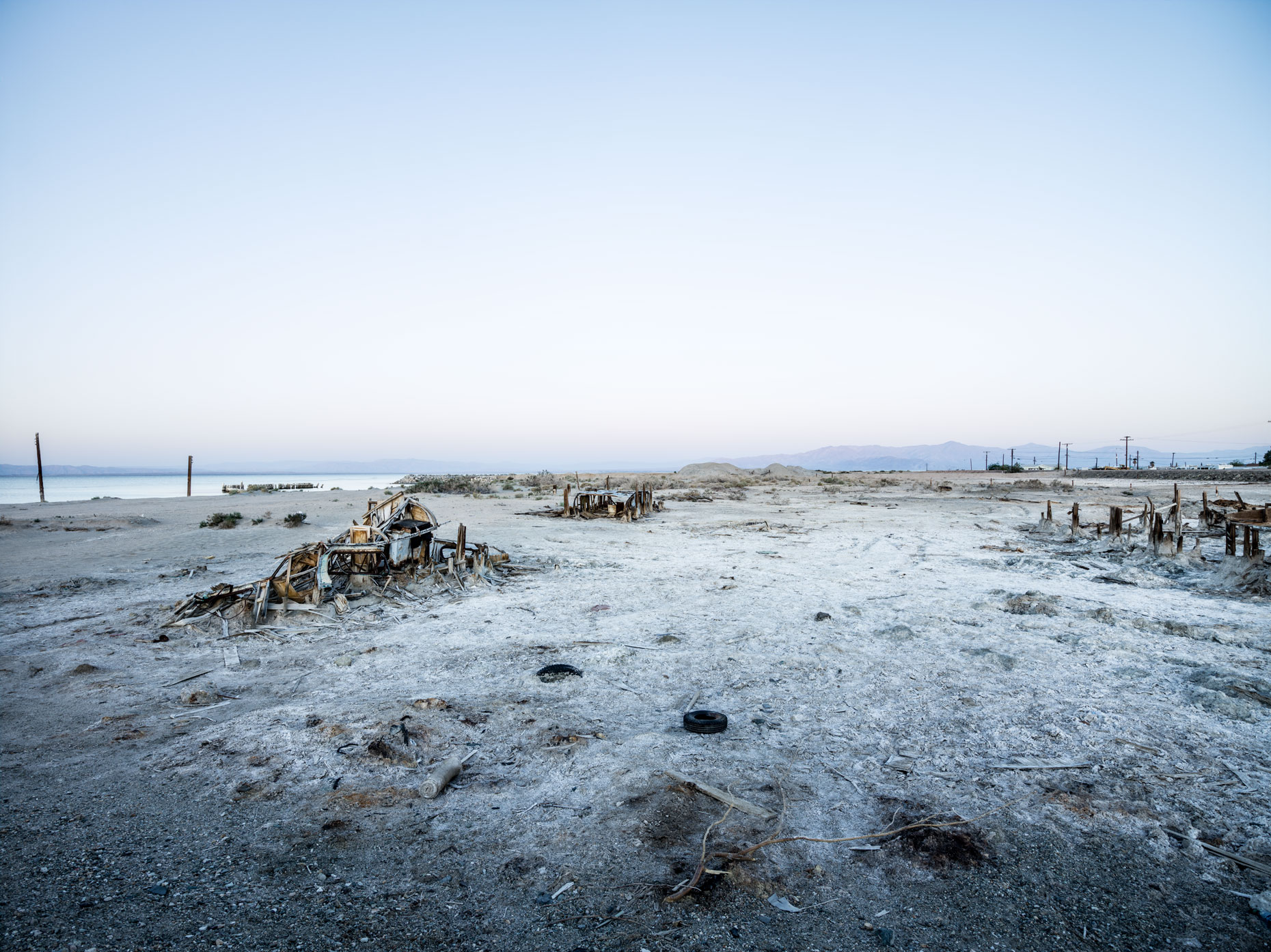 Bombay Beach empty lot of sand with wrecked ships on the Salton Sea