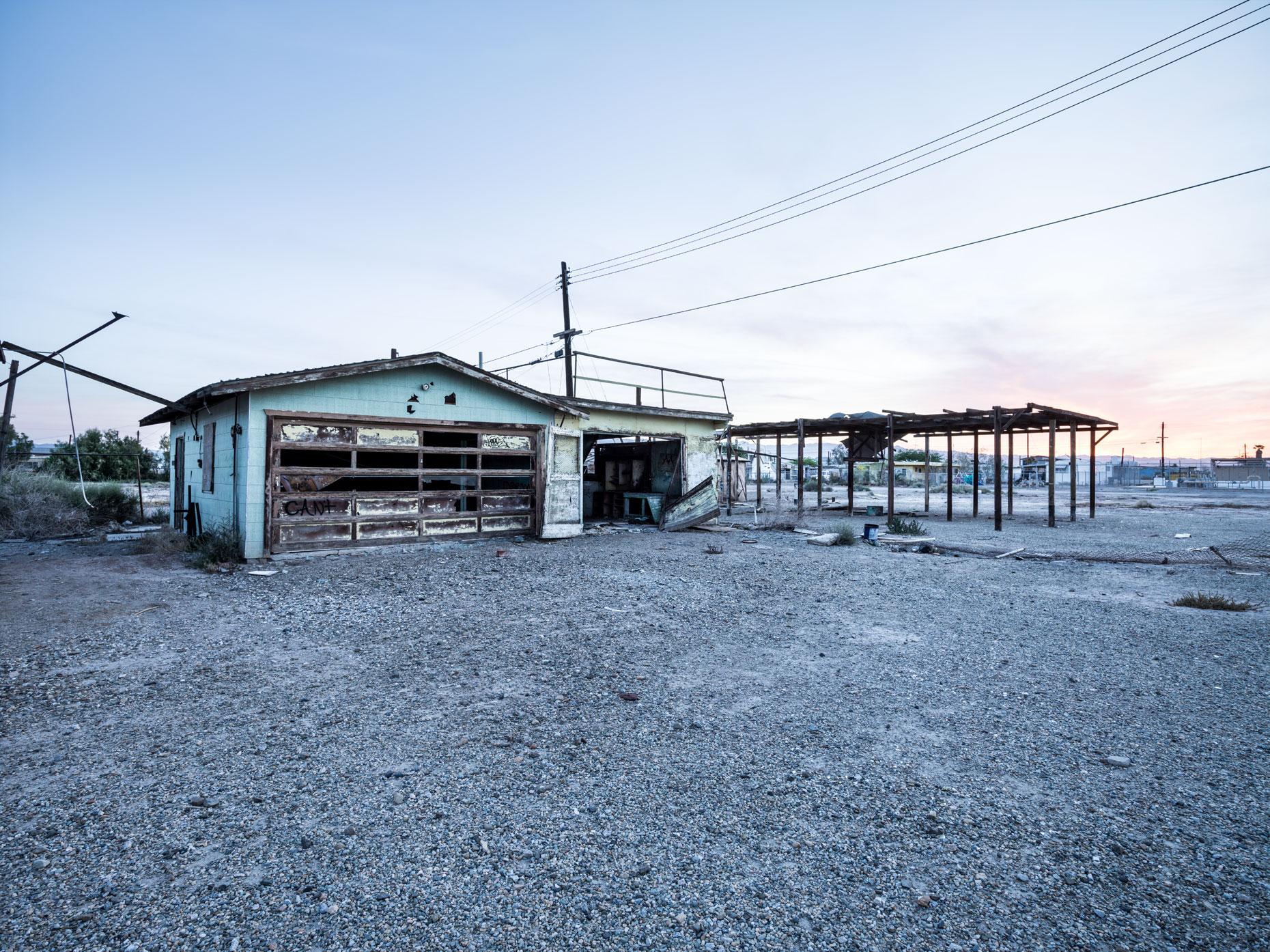 Bombay Beach decaying shed and house in the ghost town