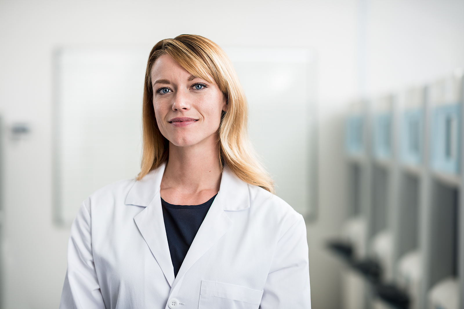 Woman in a medical lab coat