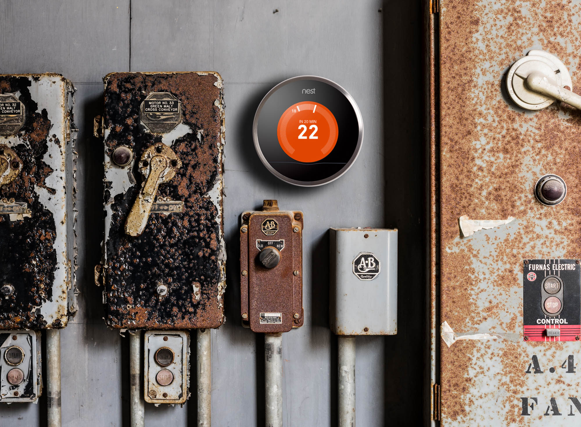 Nest thermostat on rusty wall
