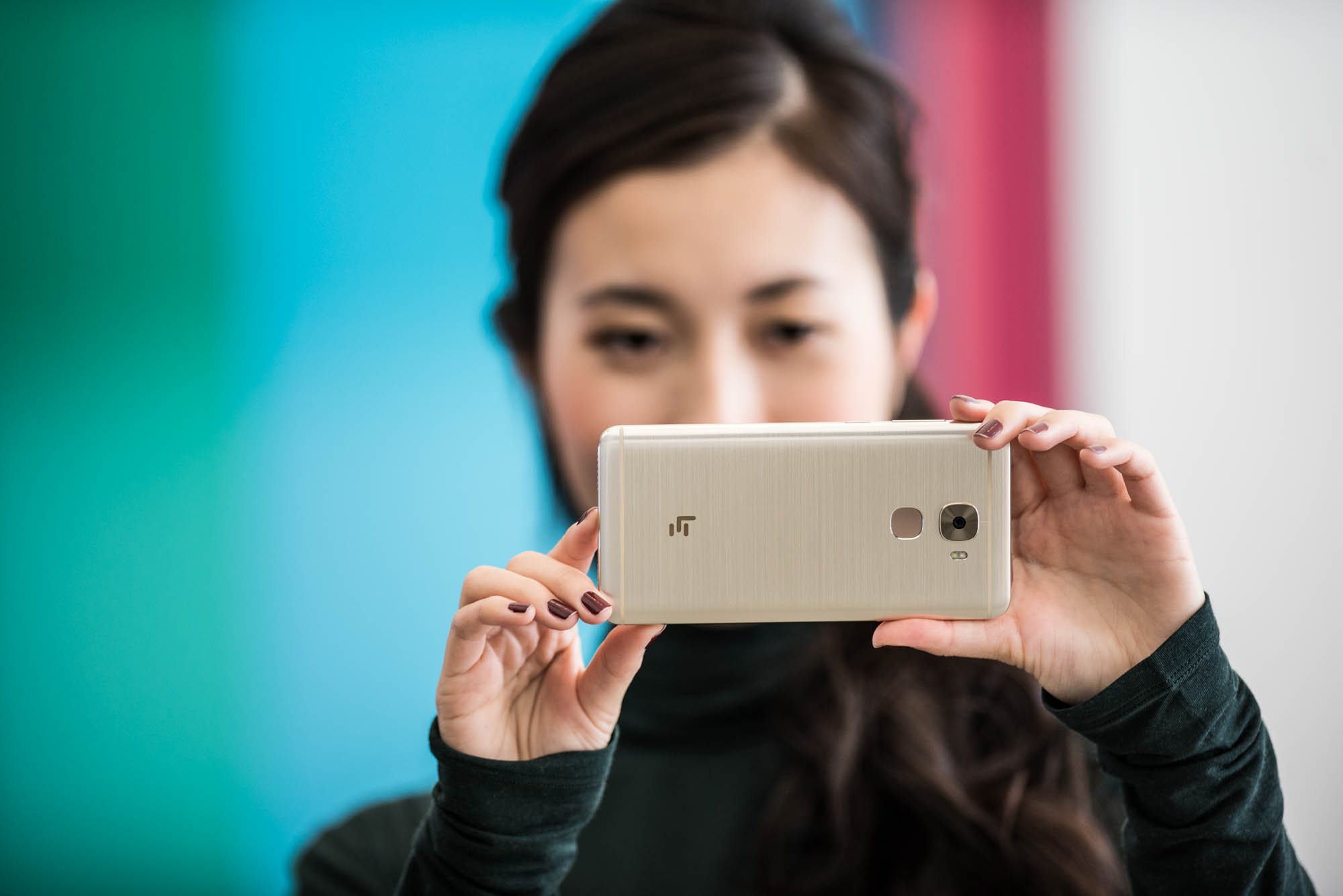 Woman holding a LeEco phone horizontally