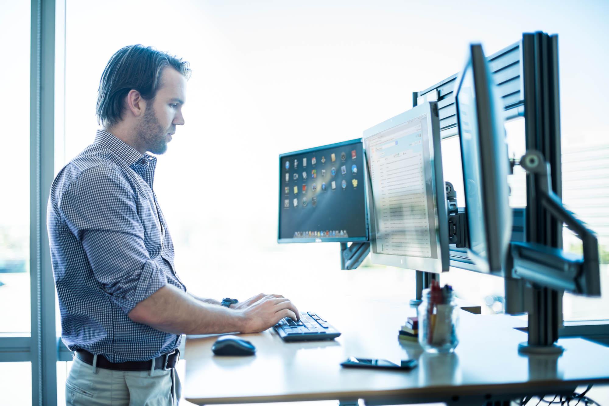 Man-working-on-monitors-Jordan-Reeder.jpg