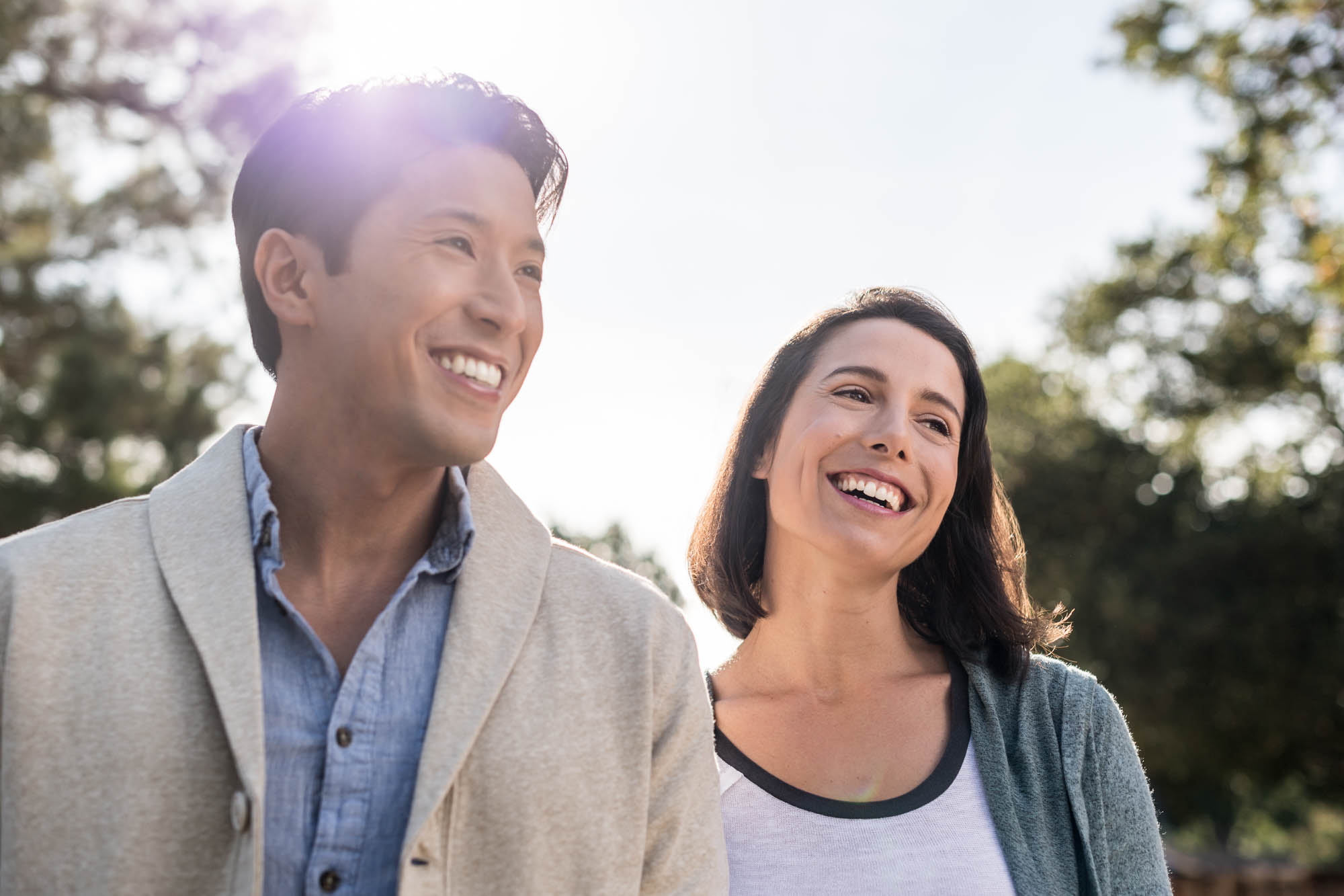 Young couple smiling in the sun