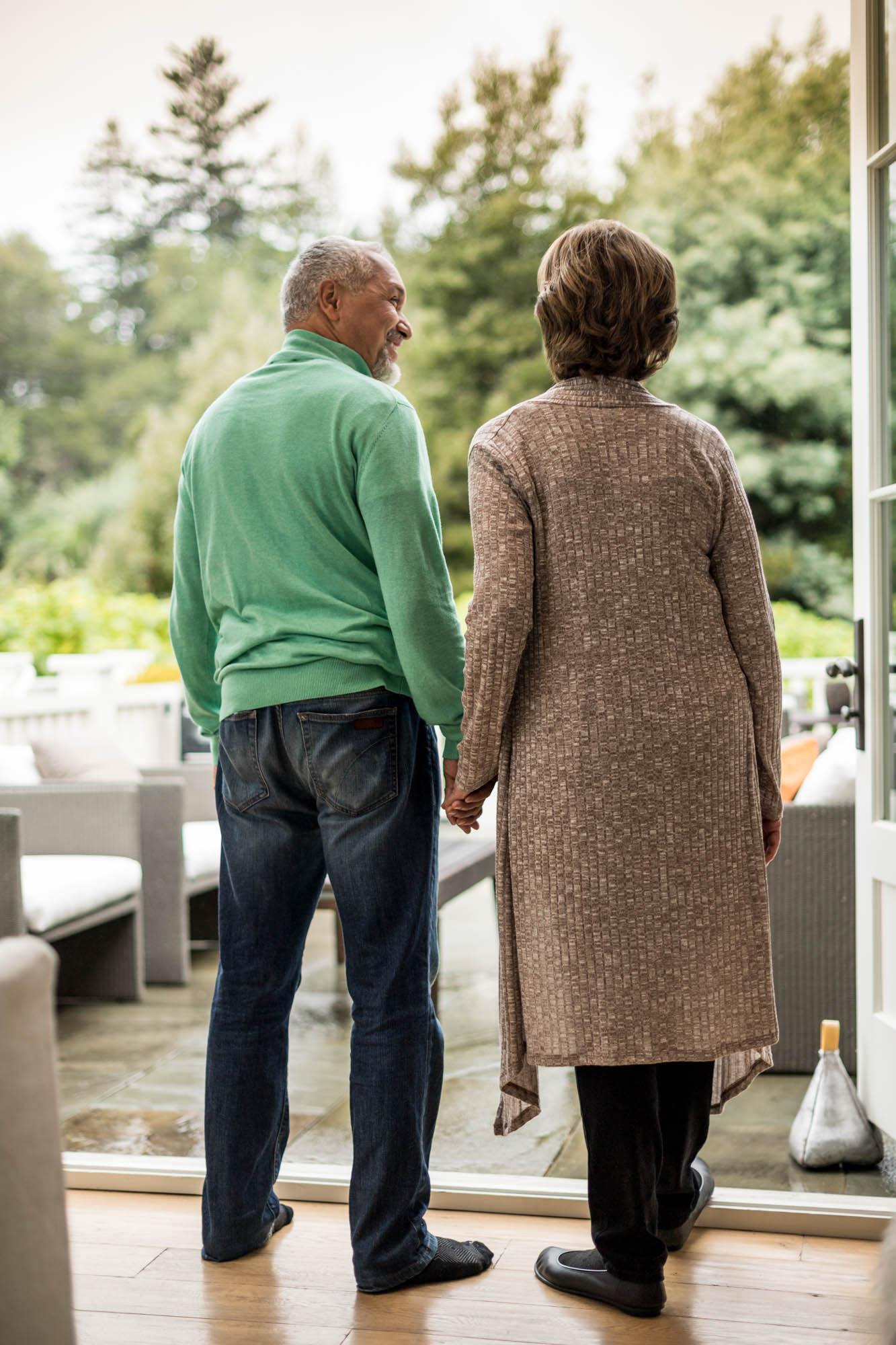 older couple walking in a backyard