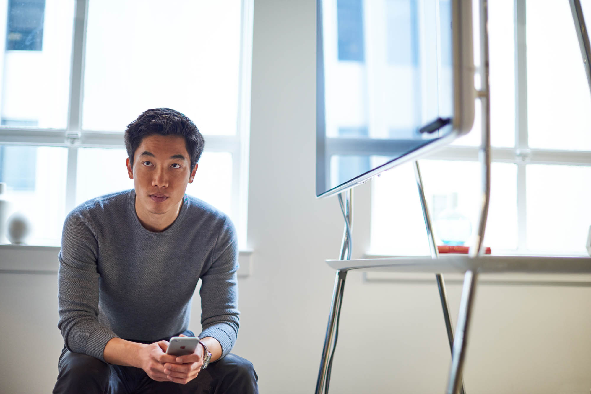 Young Asian man sitting in a modern office