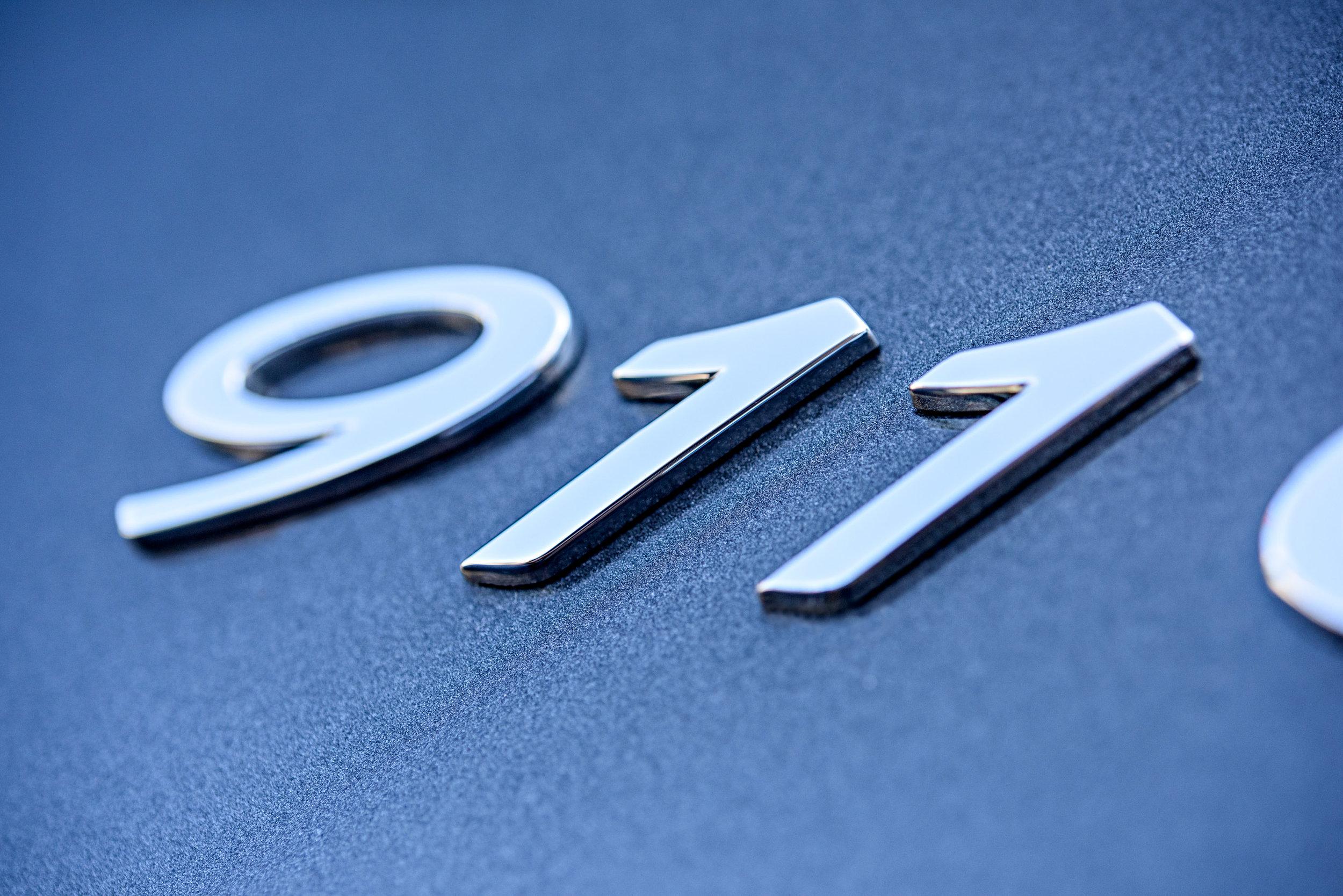 porsche 911 carrera s 2012 emblem by Jordan Reeder