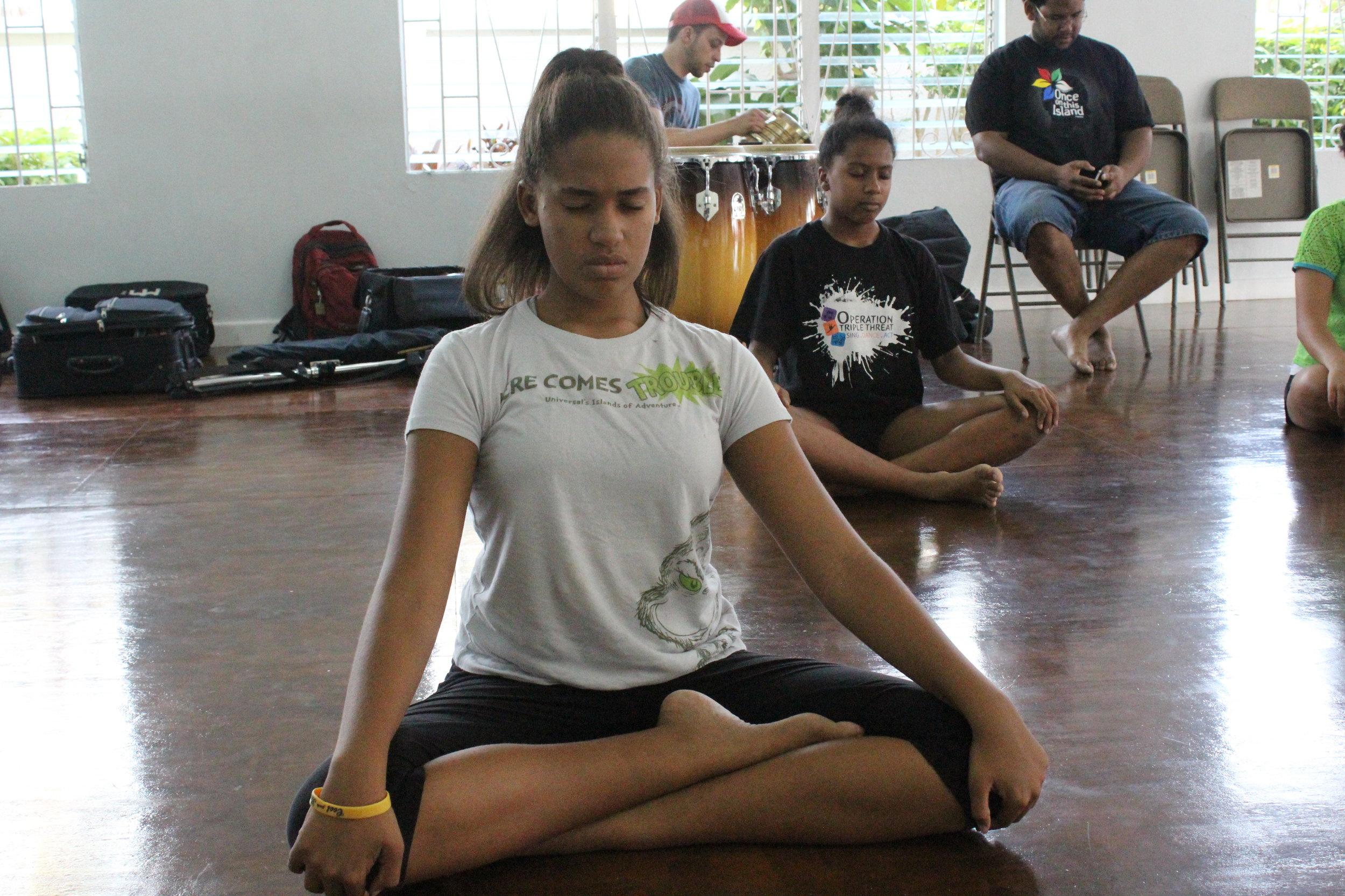 students settling into the meditation